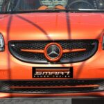 Front grille SLS in red with original Mercedes emblem for Smart Fortwo 453