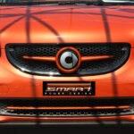 Front grille SLS in color lava orange metallic with original Smart emblem for Smart Fortwo 453