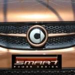 Front grille SLS in color hazel brown metallic with original Smart emblem for Smart Fortwo 453